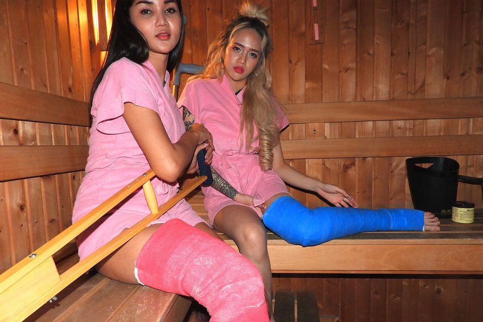 2 Girls with Long Cast Leg in sauna